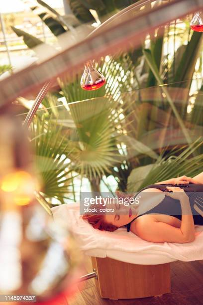 wellbeing and beauty concept. - infrared lamp stock photos and pictures