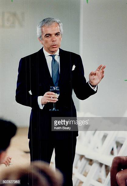 Well-bred collection: Righ; Ralph Lauren celebrates with a glass of Perrier after the showing of his spring/summer collection.