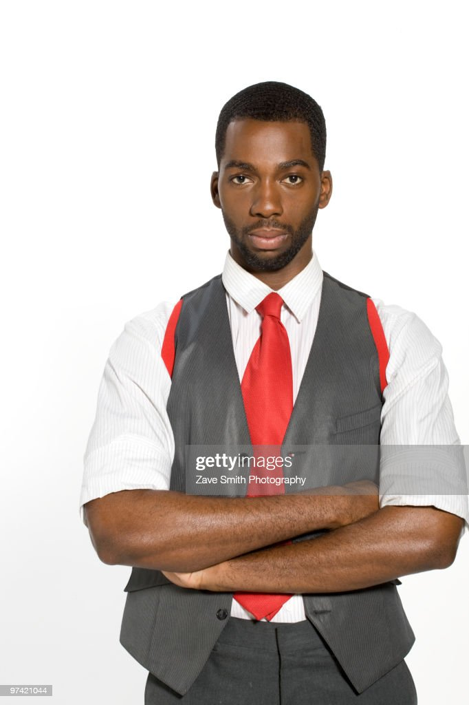 Well-dressed African man with arms crossed : Stock Photo