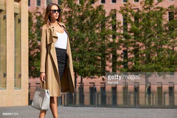 Well-dressed businesswoman walking on street