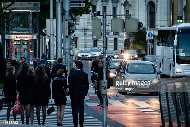 CONTENT] Welldressed commuters in Vienna at dusk in the business district