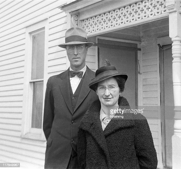 well-dressed couple in coats and hats 1941, retro - home front stock pictures, royalty-free photos & images