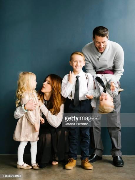 well-dressed family with three children - 2 3 jahre stock-fotos und bilder