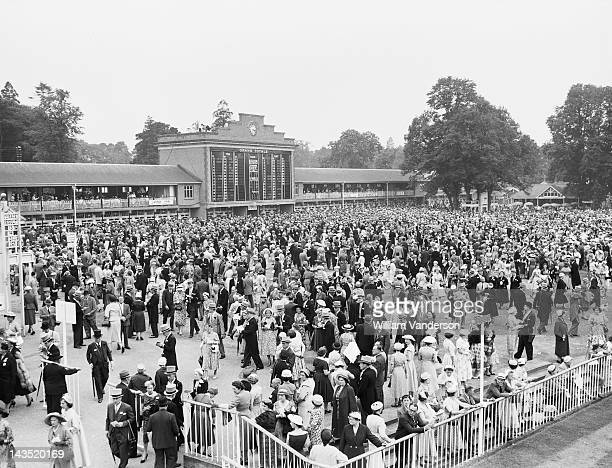 Well-dressed racegoers on the Paddock Lawns, on the second day of Royal Ascot, 19th June 1957.