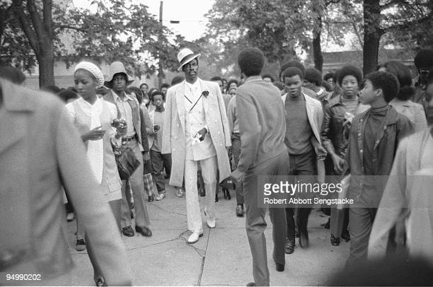 A welldressed senior member of the Omega Psi Phi fraternity parades down the grounds of Fisk University as part of fraternity pledges' initiation...