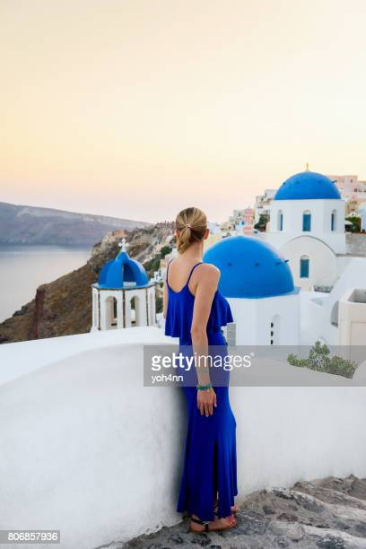 Well-dressed woman in Santorini looking at view