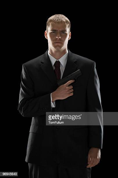 Well-Dressed Young Man With Gun