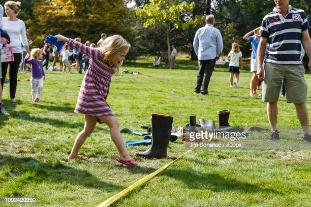 wellie throw, grey's green village fete - jim donahue stock pictures, royalty-free photos & images