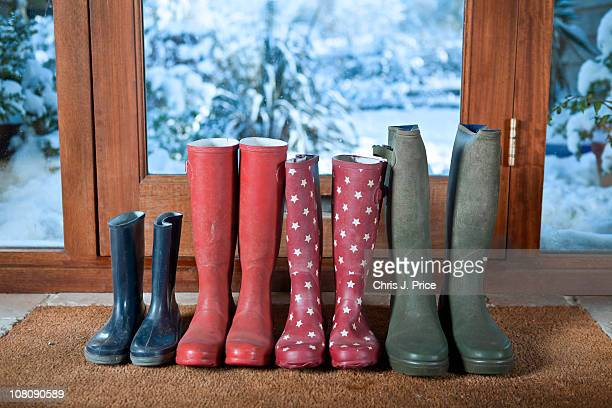 wellies on doormat - wellington boot stock pictures, royalty-free photos & images