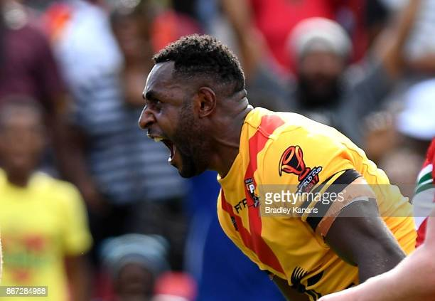 Wellington Albert of Papua New Guinea celebrates scoring a try during the Rugby League World Cup match between Papua New Guinea and Wales at Oil...