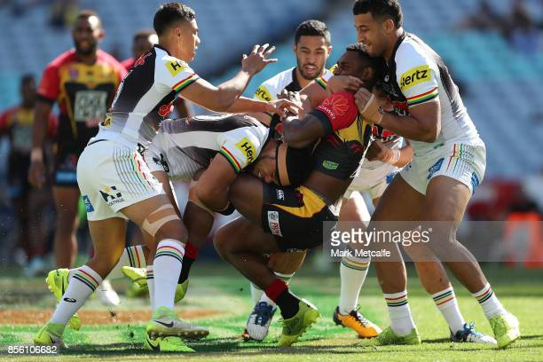 Wellington Albert of the Hunters is tackled during the 2017 State Championship Final between the Penrith Panthers and Papua New Guinea Hunters at ANZ...
