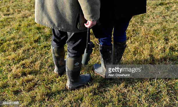 Wellington boots and binoculars during the point to point meeting at Barbury Castle racecourse on December 08 2013 in Swindon England