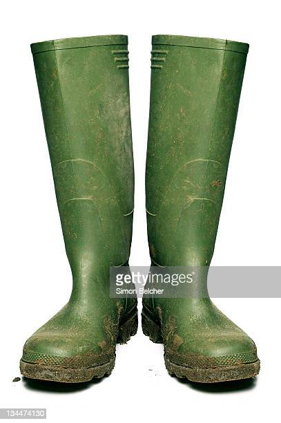 wellington boots covered in mud - rubber boot stock pictures, royalty-free photos & images