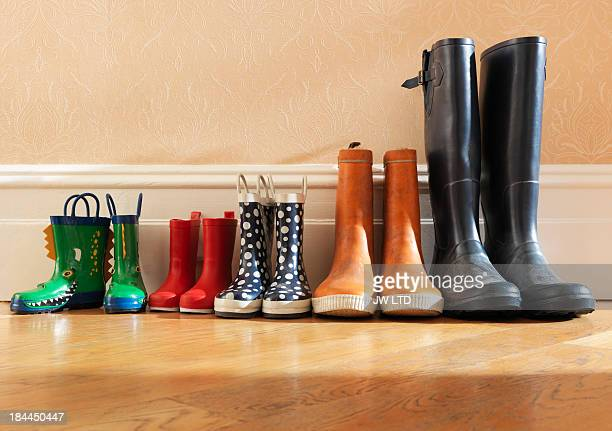 wellington boots in a row in hallway