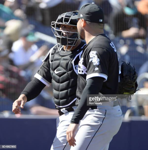 Wellington Castillo talks to Hector Santiago of the Chicago White Sox during the game against the Seattle Mariners on February 24 2018 at the Peoria...