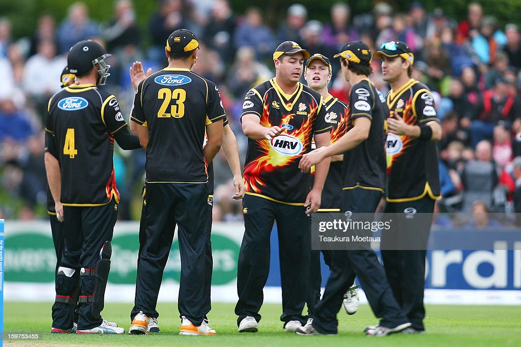 Wellington celebrate a wicket during the HRV T20 Final match between the Otago Volts and the Wellington Firebirds at University Oval on January 20, 2013 in Dunedin, New Zealand.