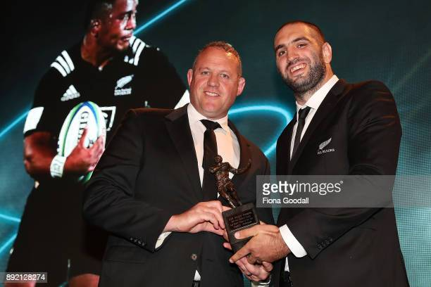 Wellington coach Chris Gibbes accepts the New Zealand Rugby Age Grade Player of the Year award for Asafo Aumua of Wellington from All Black Sam...