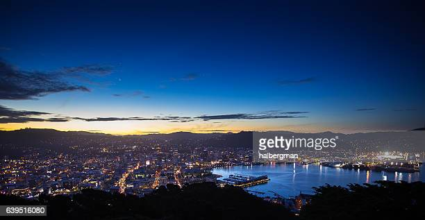 wellington harbour and city from mount victoria after sunset - wellington new zealand stock photos and pictures