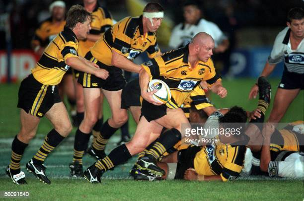 Wellington Hurricanes Mark Allen leads a charge against the Auckland Blues during their inagural Super 12 match played at the Palmerston North...