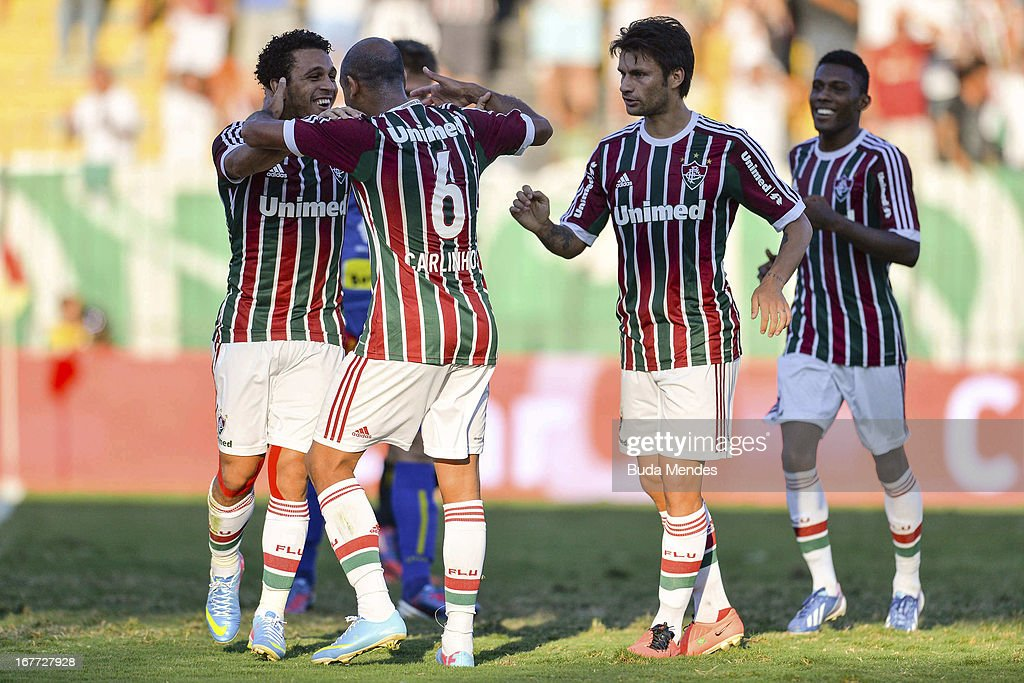 Wellington Nem, Carlinhos, Rafael Sobis and Rhayner of Fluminense celebrates a scored goal during the match between Fluminense and Volta Redonda as part of Rio State Championship 2013 at Raulino de Oliveira Stadium on April 28, 2013 in Volta Redonda, Brazil.