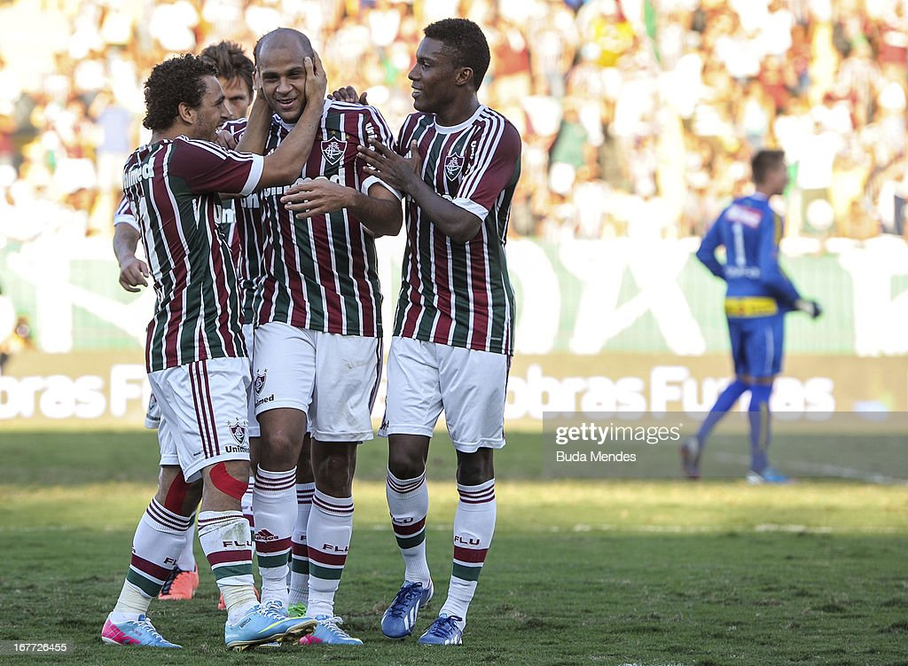 Wellington Nem, Carlinhos, Rhayner of Fluminense celebrates a scored goal during the match between Fluminense and Volta Redonda as part of Rio State Championship 2013 at Raulino de Oliveira Stadium on April 28, 2013 in Volta Redonda, Brazil.