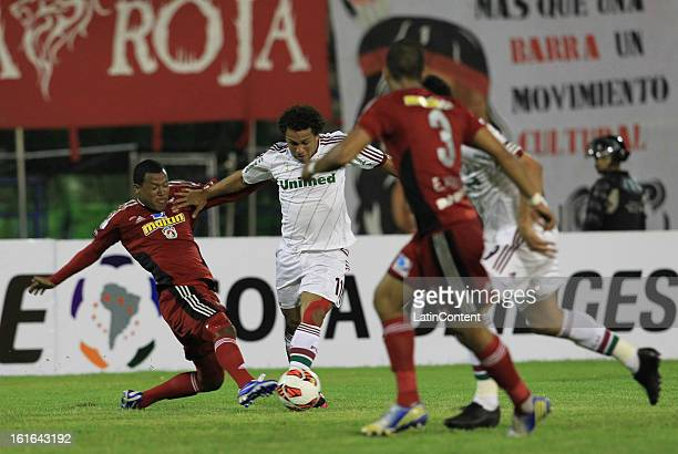 Wellington Nem of Fluminense fights for the ball with Antonio da Silva of Caracas FC during a match between Caracas FC and Fluminense as part of the...