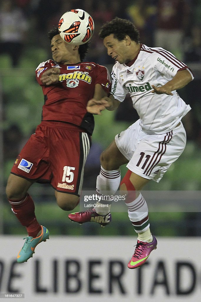 Wellington Nem of Fluminense fights for the ball with Romulo Otero of Caracas FC during a match between Caracas FC and Fluminense as part of the 2013 Copa Bridgestone Libertadores at the Olympic Stadium on February 13, 2013 in Caracas, Venezuela.