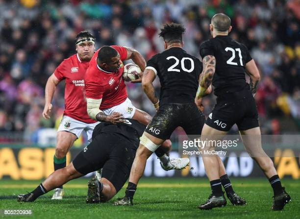Wellington New Zealand 1 July 2017 Kyle Sinckler of the British Irish Lions is tackled by Charlie Faumuina of New Zealand during the Second Test...
