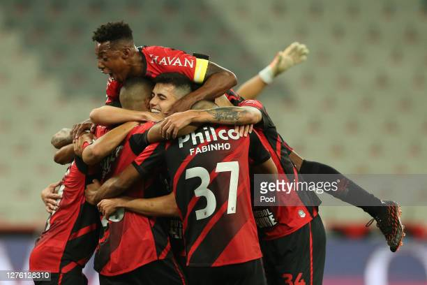 Wellington of Athletico Paranaense and teammates celebrate the second goal of their team scored by Gabriel Suazo on his own goal during a group C...
