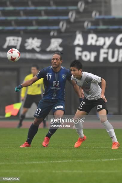 Wellington of Avispa Fukuoka and Tatsuya Uchida of Tokyo Verdy compete for the ball during the JLeague J1 Promotion PlayOff semi final match between...
