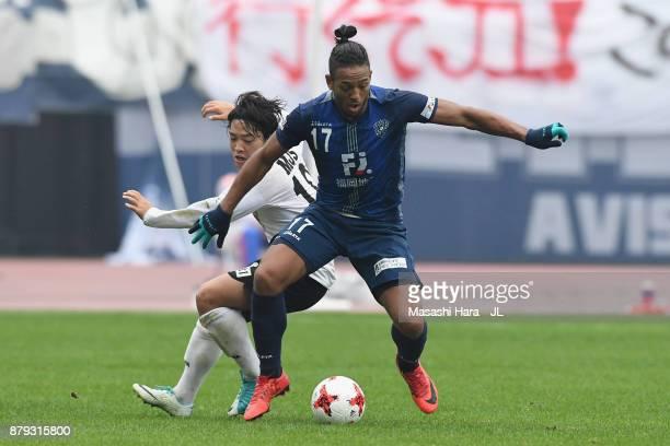 Wellington of Avispa Fukuoka controls the ball under pressure of Yoshiaki Takagi of Tokyo Verdy during the JLeague J1 Promotion PlayOff semi final...