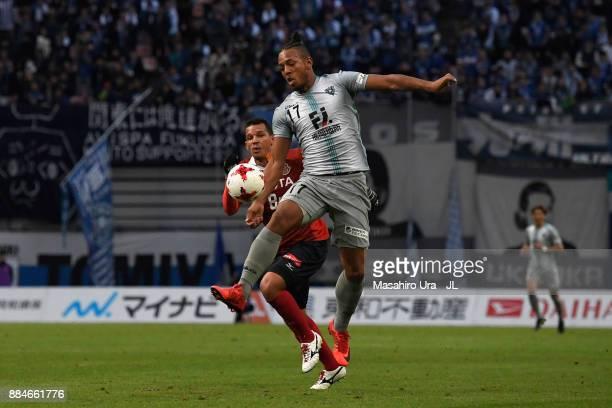 Wellington of Avispa Fukuoka controls the ball under pressure of Washington of Nagoya Grampus during the J.League J1 Promotion Play-Off Final between...