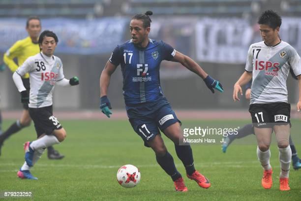 Wellington of Avispa Fukuoka controls the ball under pressure of Tokyo Verdy defense during the JLeague J1 Promotion PlayOff semi final match between...