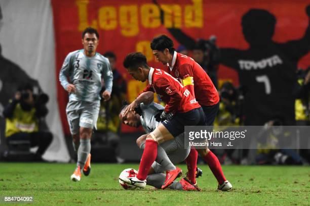Wellington of Avispa Fukuoka controls the ball under pressure of Taishi Taguchi and Yuki Kobayashi of Nagoya Grampus during the J.League J1 Promotion...