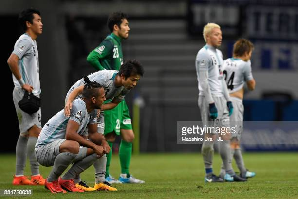 Wellington of Avispa Fukuoka is consoled by Koji Yamase as they missed the promotion after the scoreless draw in the JLeague J1 Promotion PlayOff...
