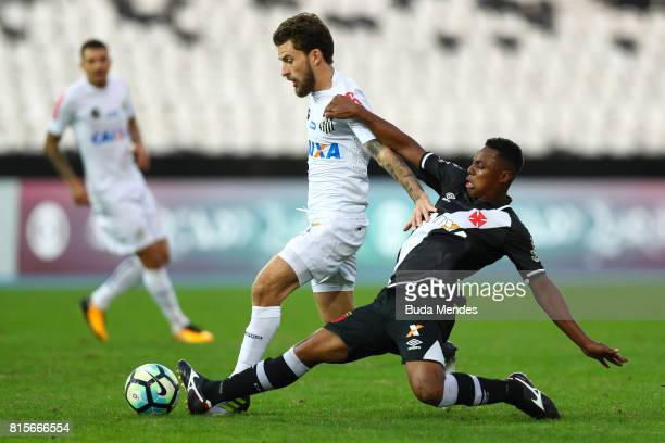 Wellington of Vasco da Gama struggles for the ball with Lucas Lima of Santos during a match between Vasco da Gama and Santos as part of Brasileirao...