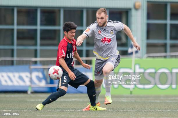 Wellington Phoenix's Hamish Watson competes with Kashima Antlers's Erick Yutaka Maya Fujll for the ball during their Main Tournament match part of...