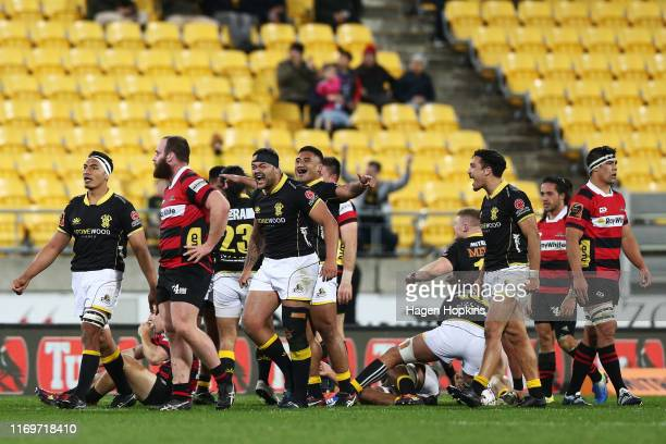 Wellington players celebrate while Canterbury players look on in disappointment at the final whistle during the round 3 Mitre 10 Cup match between...