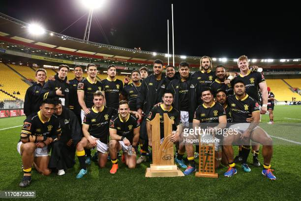 Wellington players pose with the Jonah Tali Lomu Memorial Trophy and Paladin Trophy after winning the round 4 Mitre 10 Cup match between Wellington...
