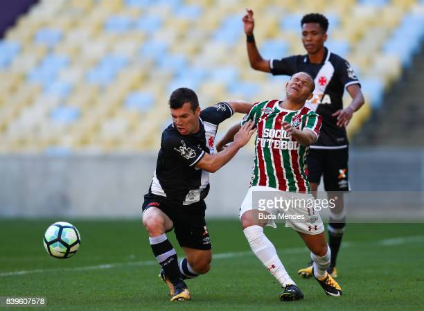 Wellington Silva of Fluminense struggles for the ball with Wagner of Vasco da Gama during a match between Fluminense and Vasco da Gama as part of...