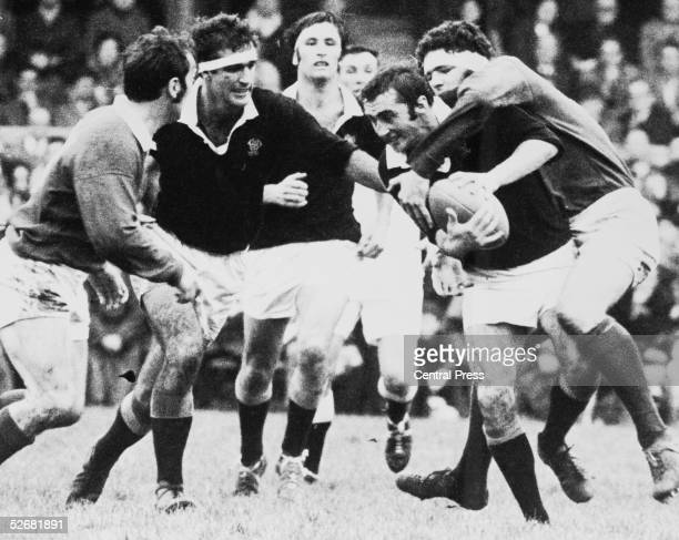 Wellington's Andy Leslie tries to get clear of the British Lions' Mervyn Davies during a match at Wellington 10th June 1971 The Lions won 479