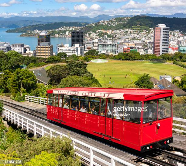wellington's cable car in front of the city's skyline - wellington new zealand stock pictures, royalty-free photos & images