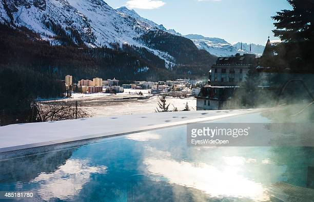 Wellness area and swimming pool interior of the luxury Kulm Hotel with panoramic view on the city and the frozen Lake of St Moritz on December 14...