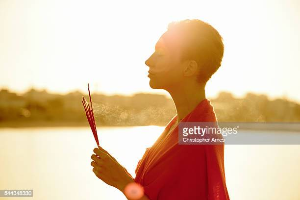 wellness - dawn meditation with incense sticks - ceremony stock pictures, royalty-free photos & images