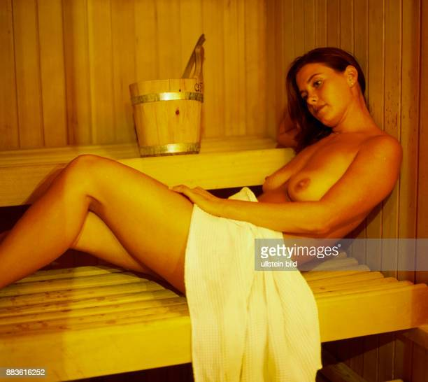 wellness Wellbeing Relax young woman in a sauna sweating hot nude naked
