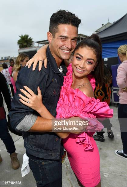 Wells Adams and Sarah Hyland attend FOX's Teen Choice Awards 2019 on August 11, 2019 in Hermosa Beach, California.