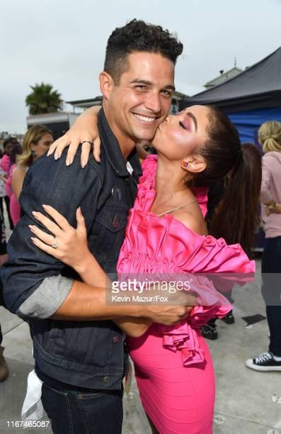 Wells Adams and Sarah Hyland attend FOX's Teen Choice Awards 2019 on August 11 2019 in Hermosa Beach California