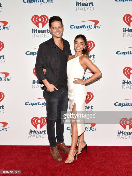 Wells Adams and Sarah Hyland pose in the press room during the iHeartRadio Music Festival at TMobile Arena on September 21 2018 in Las Vegas Nevada