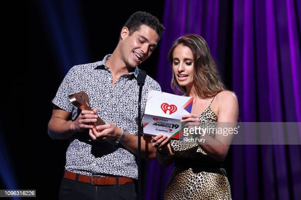 Wells Adams and Vanessa Grimaldi present award onstage at the 2019 iHeartRadio Podcast Awards Presented by Capital One at the iHeartRadio Theater LA...