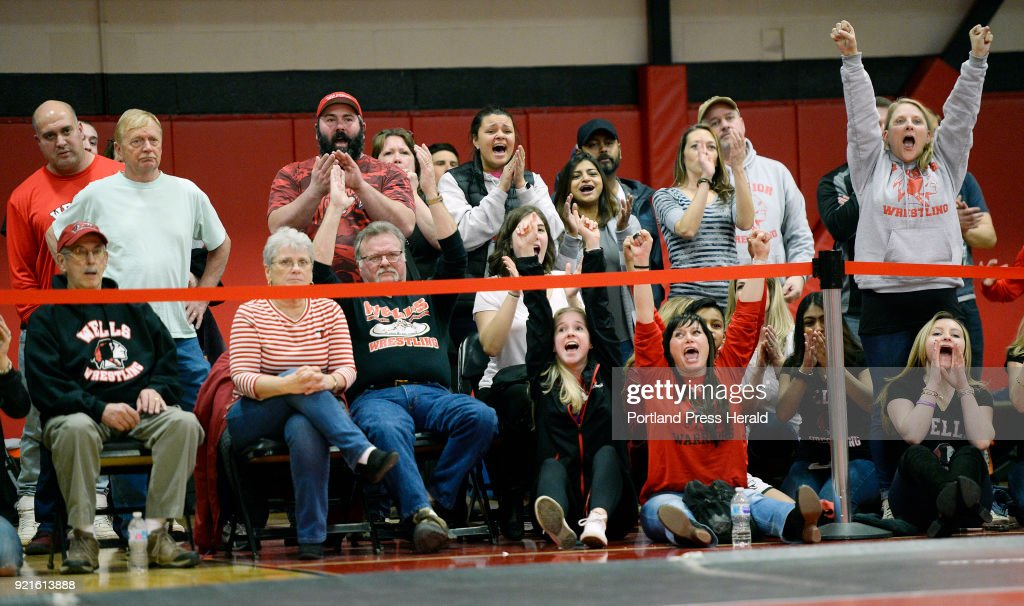Wells Fans cheer on Wells wrester Michael Wrigley during the Class B state wrestling championships at Wells High Saturday, February 17, 2018.
